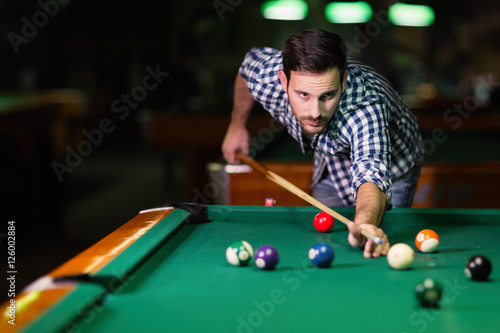 Fotografie, Tablou  Man playing pool in pub