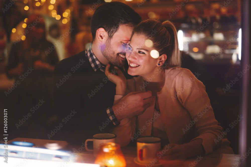 Fototapeta Couple dating at night in pub