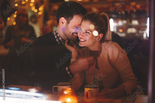 Couple dating at night in pub