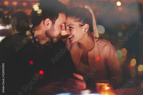 Romantic couple dating in pub