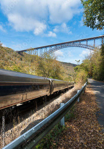 Train runs under the New River Gorge Bridge in West Virginia Canvas Print