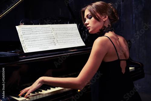 Fotografie, Obraz  Charming elegant woman in black evening dress with naked back pl