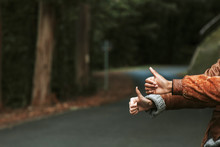 Hands Hitchhike Signal