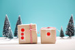 Gift boxes in a snow covered miniature forest