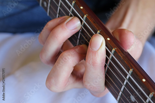 Fotografia, Obraz  Guitarist's hand forming a chord on the fretboard.