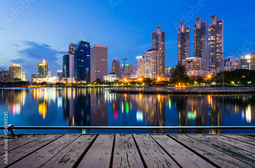 Business buildings in Bangkok with water reflection, Walkway woo
