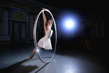 Professional Circus Performer Rotate On Cyr Wheel