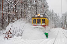 Tram With Snow Blower Clears Snow On Public Tram Railways During A Blizzard