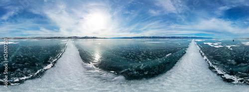 Fotografia  cylindrical panorama 360 a big white cracks on the ice of Lake B