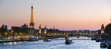 Fototapeta Paris - Paris, traffic on the Seine river at sunset, with Eiffel tower i