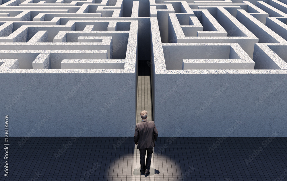 Valokuva  Business man walking to challenge an endless maze, conceptual image representing