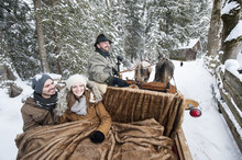 Couple Enjoying A Ride In A Horse-drawn Sleigh In Winter