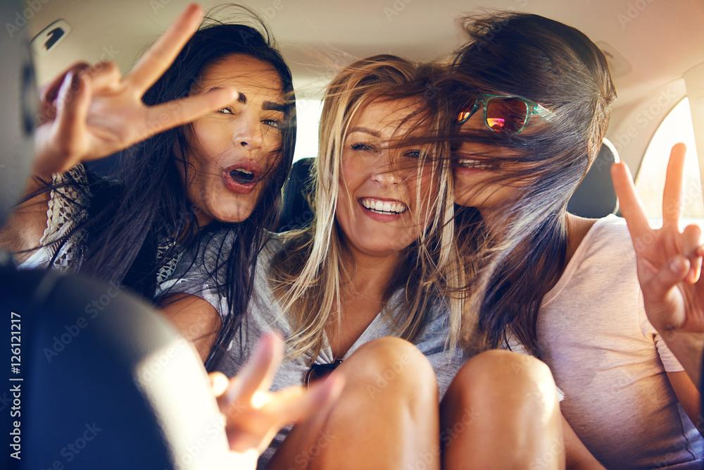 Fototapety, obrazy: Three beautiful female friends make peace signs
