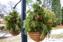 Holiday Baskets Hanging On Black Pole