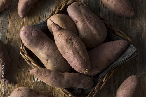 Fotografie, Obraz  Raw Organic Purple Sweet Potatoes