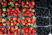 Fresh Strawberries And Blackberries In The Local Market