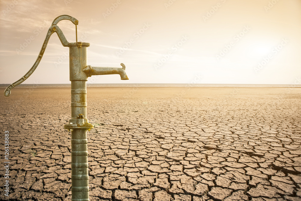 Old water pipe  in the desert. The global shortage of water on the planet.
