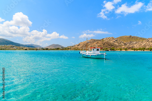 Typical Greek fishing boat sailing on turquouise sea water on Paros island, Gree Wallpaper Mural