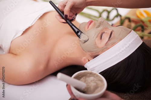 Fotografie, Obraz  Spa therapy for young woman having facial mask at beauty salon - indoors