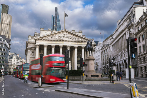 Foto op Canvas Londen rode bus London, England - The Royal Exchange building with moving red double decker buses