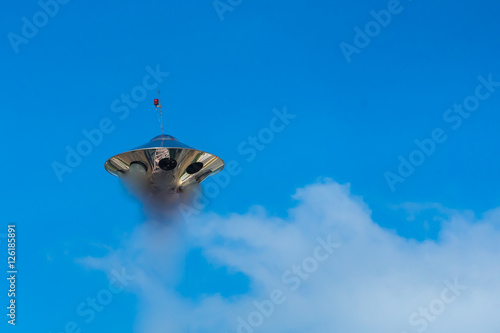 Foto op Canvas UFO UFO and blue sky with white clouds.