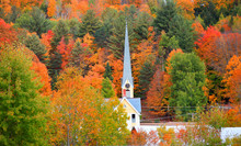 Church Steeple Between Autumn Foliage