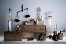 Monastery Pharmacy. Bottles, Jars, Scales, A Kerosene Lamp On Wooden Shelves