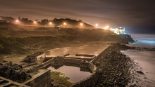 Sutro Baths Ruins With A Distant House In San Francisco At Night