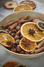 Bowl Of Hazelnut With Cinnamon Sticks, Star Anise And Dried Citrus