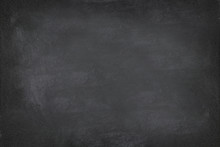 Black Chalkboard Blackboard Chalk Texture Background. Black Chalk Board Texture Empty Blank With Writing Chalk Traces Erased On The Board. Copyspace For Text Advertisement. School Board Display.