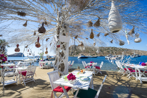 Poster Turquie Informal beachside seating with decorative tree in a scenic tourist village near Bodrum, Turkey