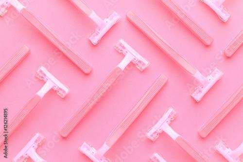 many women razors on the pink background