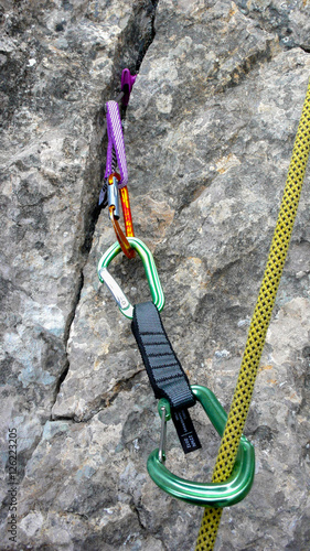Photo Stands Mountaineering rock climbing and placing mobile protection in the Swiss Alps