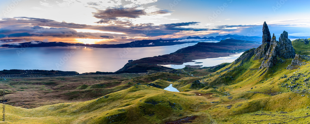 Fototapeta Sunrise at the most popular location on the Isle of Skye - The Old Man of Storr - beautiful panorama of an amazing scenery with vivid colors and picturesque panorama - symbolic tourist attraction