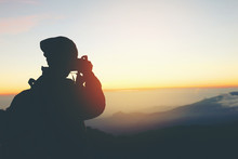 Silhouette Of Photographer Tak...