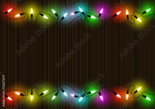 colorful glowing christmas lights over mahogany background with colored light dust effect abstract illustration