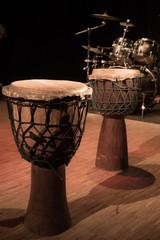 Fototapeta na wymiar Traditional wooden african djembe drumon stage