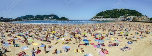 La Concha Beach crowded at sea, in San Sebastian, Spain