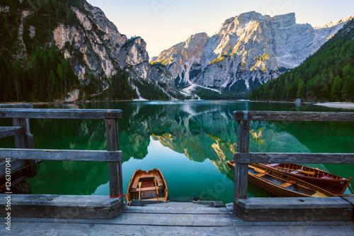 Poster Lac / Etang Boats on the Braies Lake ( Pragser Wildsee ) in Dolomites mounta