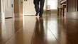 A man walking around kitchen in pajamas low shot
