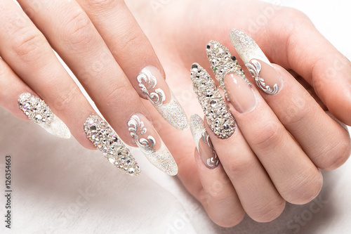 Fotografie, Obraz  Beautifil wedding manicure for the bride in gentle tones with rhinestone