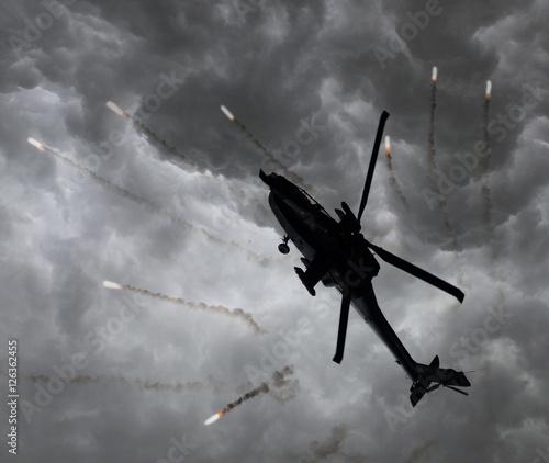 Türaufkleber Hubschrauber Silhouette of an attack helicopter firing flares