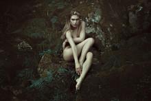 Dark Forest Dryad Posing On Mossy Rocks