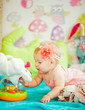 The baby playing with toys in room