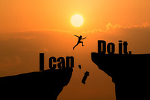 Man Jumping On I Can Do It Or I Can't Do It Text Over Cliff On Sunset Background