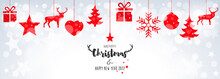 Christmas Card With Hanging Red Decorations On Bokeh