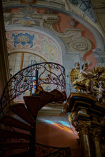 Look From Below At Old Spiral Stairs In Beautiful Room