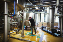 Man Working In A Brewery Adjus...
