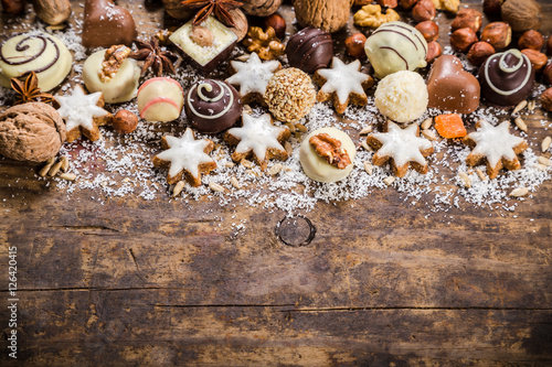 Confiserie wooden background with sweets and chocolate