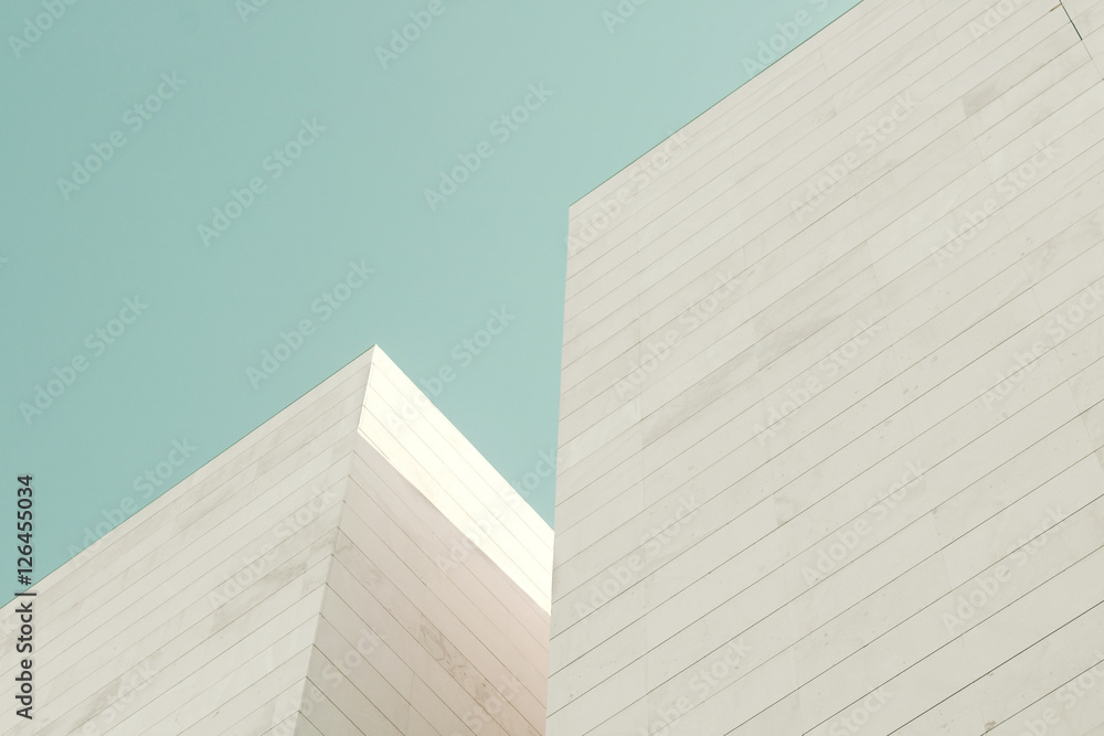 Fototapeta Abstract architecture. Detail of a building facade made of stone blocks